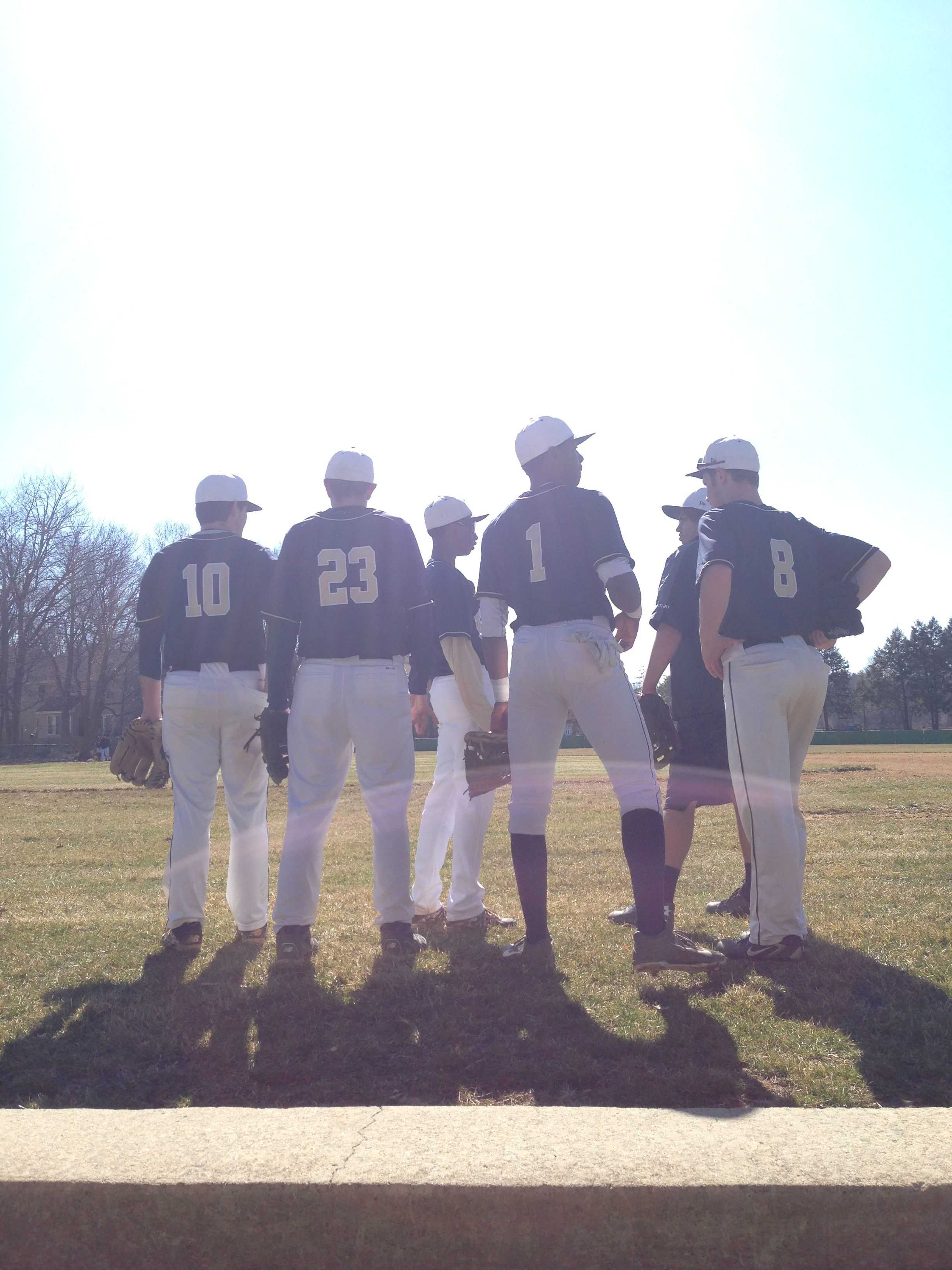 The varsity baseball team gathers before their game against Lawrenceville.