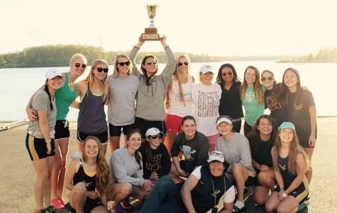 The girls crew team poses with their trophy from the MAPL championships.