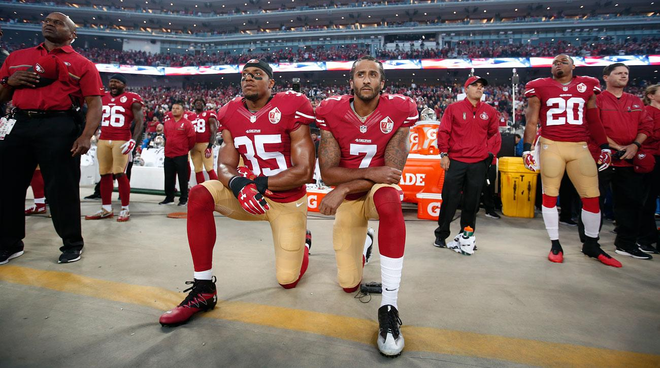 Colin Kaepernick takes a knee during the national anthem. Photo courtesy Sports Illustrated.