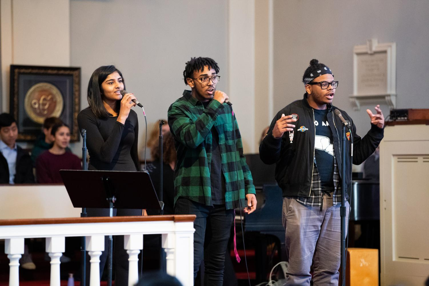 From left to right: Kavya Borra '20, Zion Henriques '20, and Daniel Funderbirk '20 preforming