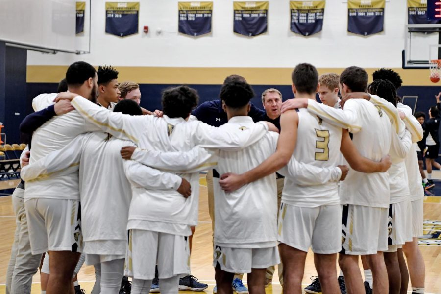 Boy%27s+Varsity+Basketball+in+a+pre-game+huddle.