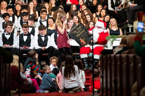 Santa reading to young children during Vespers. Photo courtesy of Andrew Marvin.